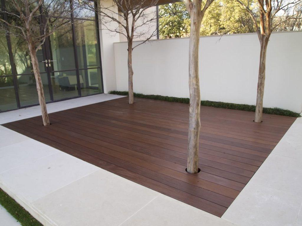 An ipe deck with trees embedded.